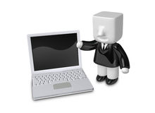 3d business man standing next to laptop. 3D Square Man Series. Stock Image