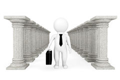 3d businessman with classic columns. On a white background Stock Image