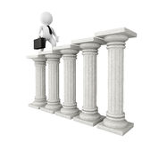 3d businessman with classic columns. On a white background Stock Photography