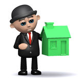 3d Businessman with a green house. 3d render of a businessman with a small green house Royalty Free Stock Image
