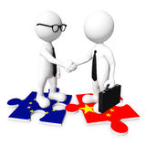 3D Businessman Handshaking on a Jigsaw Royalty Free Stock Images