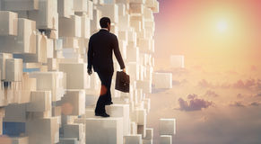 3D Businessman looking to the future. Inside an amazing scene with clouds Royalty Free Stock Image