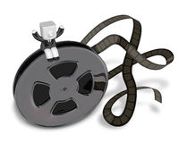 3d Businessman on Movie films spool with film. 3D Square Man Ser Royalty Free Stock Photography