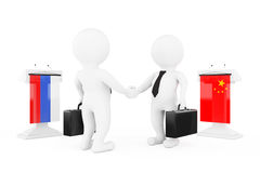 3d Businessman or Politicians Characters Shaking Hands near Trib. Unes with China and Russian Flags on a white background. 3d Rendering Royalty Free Stock Images