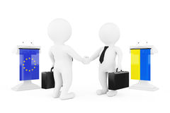 3d Businessman or Politicians Characters Shaking Hands near Trib. Unes with Ukraine and European Union Flags on a white background. 3d Rendering Royalty Free Stock Photography