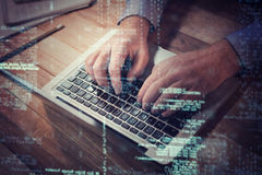 3D Businessman typing on laptop Royalty Free Stock Photo