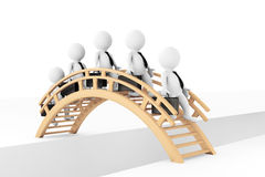 3d businessmans crossing bridge Stock Photography