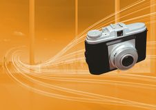 3D Camera against orange curves background. Digital composite of 3D Camera against orange curves background Royalty Free Stock Images