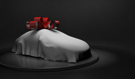 3D car wrapped under a sheet and big red bow Royalty Free Stock Images