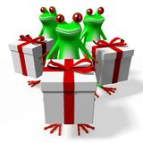 3D cartoon frogs and gift boxes Stock Photos