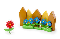 3d cartoon Red flower Stand out of a crowd - individuality Stock Photography