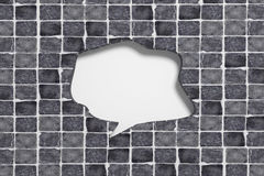 3d carved speech bubble in ceramic tile. 3d rendering close-up of empty speech sign with copy space carved in black ceramic tile Royalty Free Stock Images