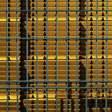 Gold Bars stacked in rows behind bars vector illustration