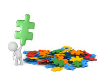 3D Character and Colorful Puzzle Pieces Royalty Free Stock Photos