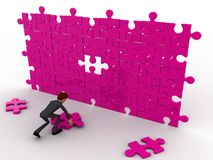 3d character completing pink puzzle concept Royalty Free Stock Images