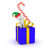 3D Character with Elf Hat, Gift, and Candy Cane Royalty Free Stock Photos