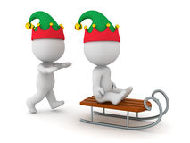 3D Character with Elf Hat Pushing another 3D Character on a Sled Royalty Free Stock Images