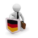 3d character with a German badge. 3d character holding a German badge, manufacturing 3d concept rendering Royalty Free Stock Photos