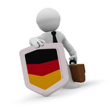 3d character with a German badge. 3d character holding a German badge, manufacturing 3d concept rendering Stock Photography