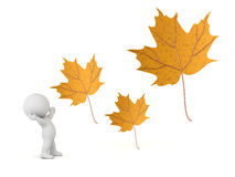 3D Character and Large Autumn Leaves Royalty Free Stock Photos