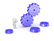 3D Character and Large Gears Royalty Free Stock Photo