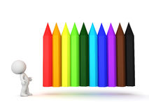 3D Character looking at rainbow colored crayons which are positi. Oned horizontally. They can considered pencils as well Stock Photos