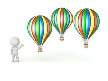 3D Character Showing Several Hot Air Balloons Royalty Free Stock Photo