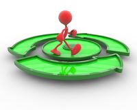 3d character is walking on the green circular arrow. Red 3d character is walking on the green circular arrow Royalty Free Stock Images