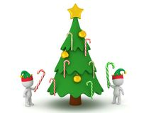 3D Characters in Elf Hats with Candy Canes and Christmas Tree. 3D characters with candy canes next to a decorated Christmas tree. Isolated on white background Stock Image