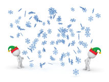 3D Characters with Elf Hats Looking Up at Falling Snowflakes Stock Photo