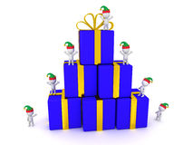 3D Characters with Elf Hats and Stack of Wrapped Gift Boxes Stock Photography