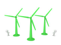3D Characters Looking Up at Wind Turbines Stock Images