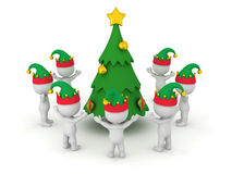 3D Characters wearing Elf Hats standing around a Decorated Carto Stock Photography