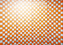 3d checkered background in orange and white tone. 3d pattern checkered background. Royalty Free Stock Photos