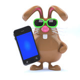 3d Chocolate Easter Bunny with smartphone. Stock Photos