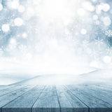 3D Christmas background with wooden table looking out to a snowy Stock Image