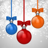 3d Christmas ball ornaments with red ribbon and bows. Background Royalty Free Stock Photo