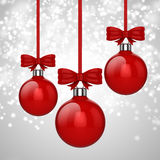 3d Christmas ball ornaments with red ribbon and bows. Background Royalty Free Stock Photography