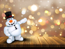 3D Christmas snowman on wooden table against a bokeh lights back Stock Photo