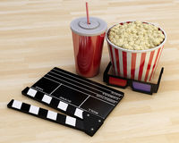 3d Cinema clapper board, popcorn and drink. 3d renderer illustration. Cinema clapper board, popcorn and drink Stock Photography