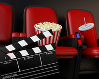 3d Cinema clapper board, popcorn and drink. Royalty Free Stock Photo