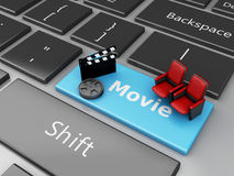 3d Cinema Clapper board and theater seat on computer keyboard. 3d illustration. Cinema Clapper board and theater seat on computer keyboard. Cinematography Royalty Free Stock Photos