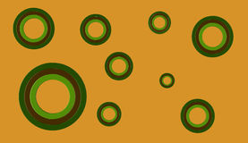 3D circular shapes on plain background. 3D render of brown and green circles of various sizes on an orange background Stock Photo