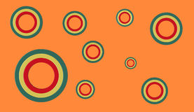 3D circular shapes on plain background. 3D render of green, yellow and red circles of various sizes on an orange background Stock Images