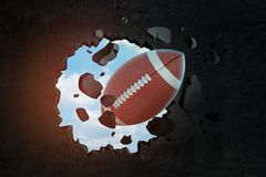 3d closeup rendering of brown oval ball for American football breaking hole in black wall with blue sky seen through. Hole. Active sports. Aggressive games vector illustration