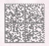 2D code barres sur le papier Photos stock