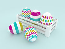 3d colored Easter eggs in wooden box Royalty Free Stock Image