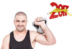 3D Composite image of bodybuilder lifting heavy kettlebell Royalty Free Stock Photography