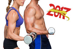 3D Composite image of bodybuilding couple. Bodybuilding couple against digitally generated image of 3D new year with tape measure Stock Photo