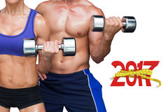 3D Composite image of bodybuilding couple. Bodybuilding couple against digitally generated image of 3D new year with tape measure Royalty Free Stock Photos